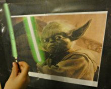 Pin the lightsaber onto Yoda just like pinning the tail on the donkey