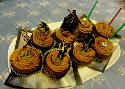 star wars cake and cupcake toppers with Yoda, Hans SOlo, Princess Leia, Luke Skywalker Darth Vader Bobba Fett and a few lightsaber party toppers